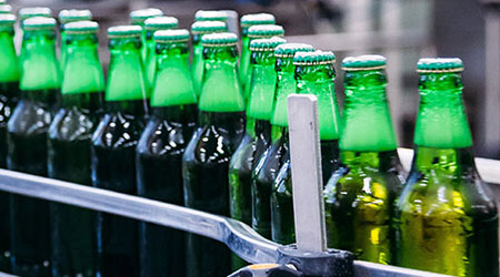 Transportation of filled bottles in the food and beverage industry.